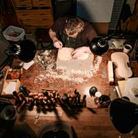 Arsenios Corbishley makes violins, violas and cellos in his shop in Farmers Market District.