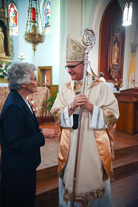 Sister Marita Rother chats with Most Reverend Paul Coakley, Archbishop of Oklahoma City, after the Anniversary Mass for Father Stanley Rother at the Holy Trinity Catholic Churche in Okarche Oklahoma on Aug. 1.  mh