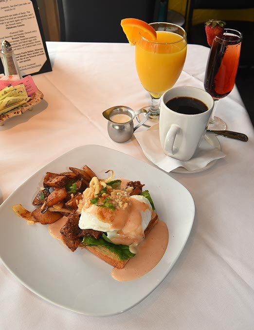 BBQ Brisket Benedict with coffee, orange juice, and Kir Royal (Creme de Cassis and Champagne), at Fancy That on Main Street in Norman.   mh