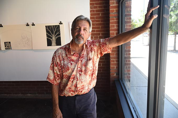 "Artist George Oswalt photographed at IAO Gallery on Film Rom where he was found working on the ""The Elaborate Colaborate"" exhibit set-up.  mh"