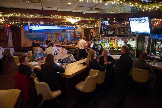 Guests enjoy cocktails and beer at Nancy's 57th Street Lighthouse in Oklahoma City. (Garett Fisbeck)