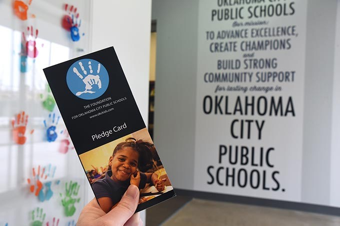 The Foundation for Oklahoma City Public Schools Pledge Card, in the entrace to their offices in Downtown Oklahoma City, 1-22-16. - MARK HANCOCK