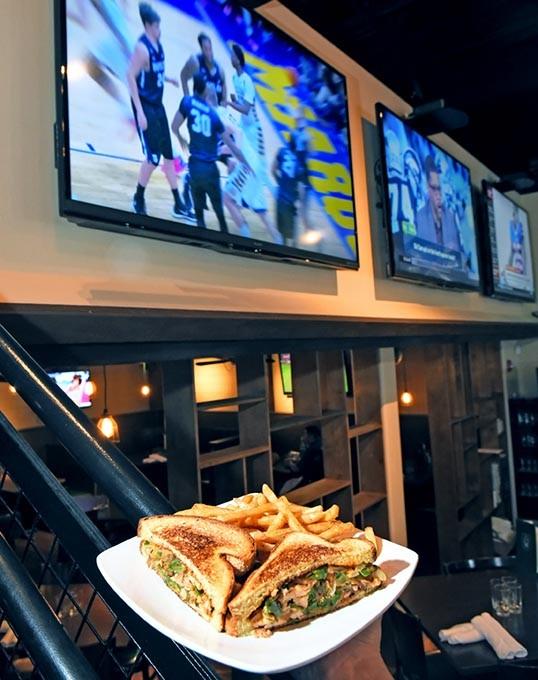 The Chupacabra sandwich with fries, at Pub W, 3720 W. Robinson Avenue in Norman, 2-8-16. - MARK HANCOCK
