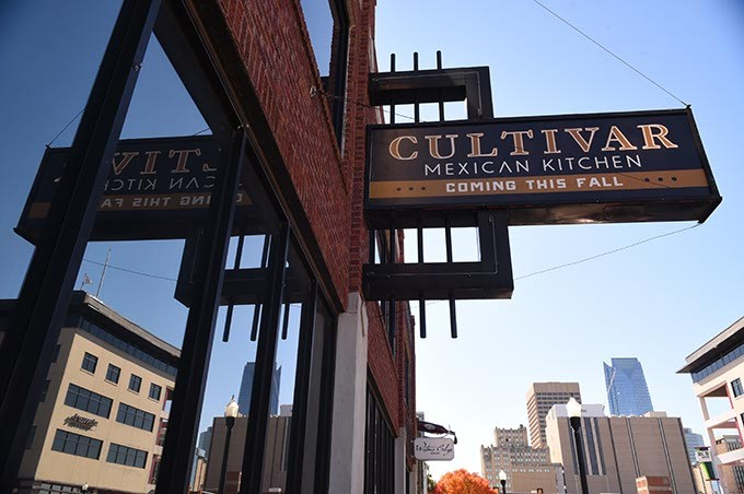 New sign of things to come, Cultivar Mixican Kitchen on Broadway Avenue in with Downtown skyline, 11-12-15. - MARK HANCOCK
