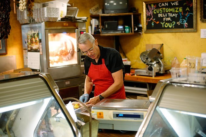 Bill Kamp works in his meat market in Oklahoma City, Friday, July 24, 2015. - GARETT FISBECK