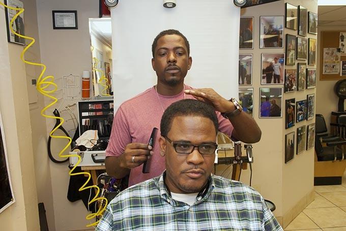 Larry Coleman works on customer Richard Clark in his Legitimate Look space. - MARK HANCOCK