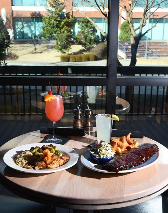 Stuffed Catfish with a KD's Breeze cocktail, left, next to Baby Back Ribs with a Loud City Lemonaid, next to the window overlooking the Bricktown Canal at KD's in Lower Bricktown, Oklahoma City, 1-25-16. - MARK HANCOCK