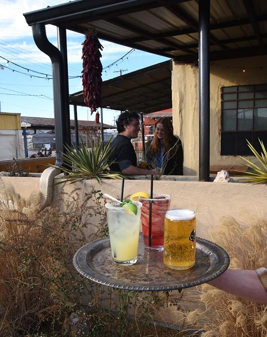 Drinks from left, Spicy Sexton Margarita, Friendly Punch, and a Power Pilsner, in the Southwest environment at Powerhouse, in the Farmer's Public Market area, Oklahoma City, 1-25-16. - MARK HANCOCK
