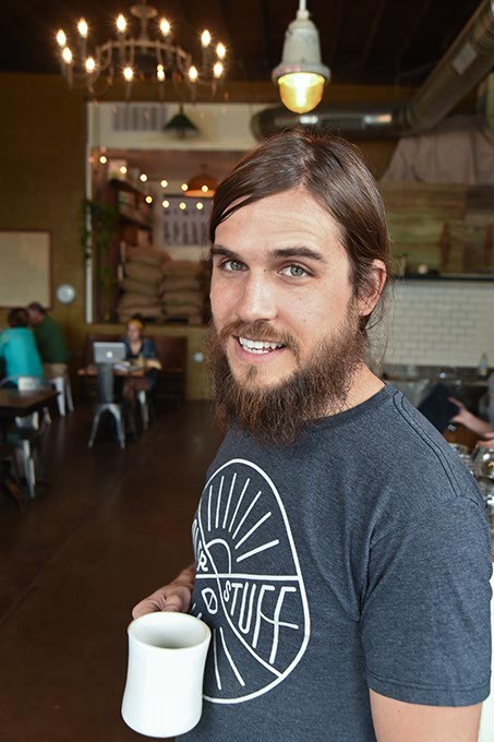 Co-owner Trey Woods at the Hoboken Coffee Roaster in Guthrie.  mh