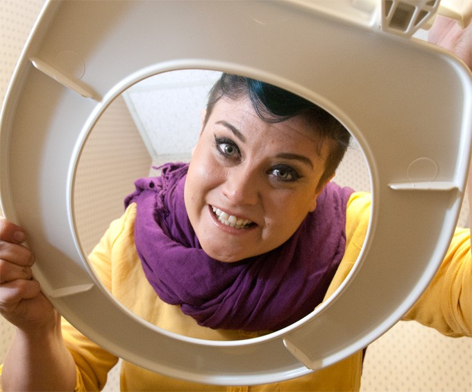 Leslie Hensley and a toilet seat. - MARK HANCOCK