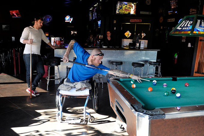 "Chris ""Maverick"" Richardson takes a shot while Shane Cox, left, looks on at Lumpy's Sports Bar and Grill in Oklahoma City, Tuesday, Nov. 18, 2014.  Photo by Garett Fisbeck - GARETT FISBECK"