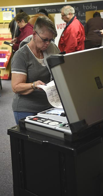 People voting during the recent general election at Highland Park Elementary in southeast OKC, 11-4-14.  mh
