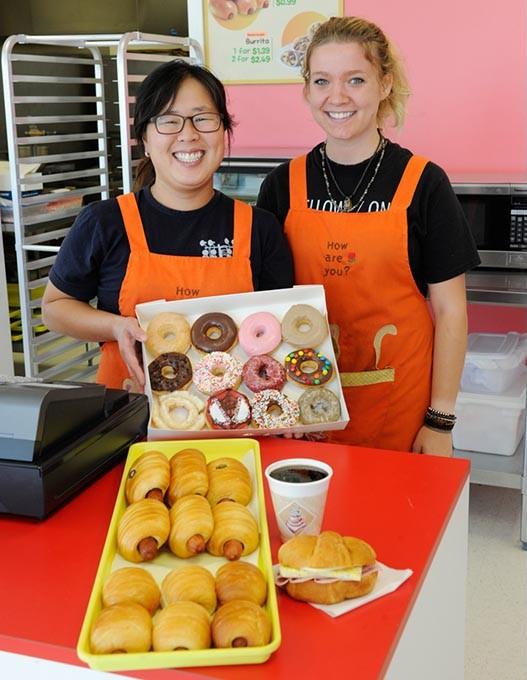 Katie Kang and Samantha Kimes poses for a photo at Donut Therapy in Oklahoma City, Thursday, Sept. 17, 2015. - GARETT FISBECK