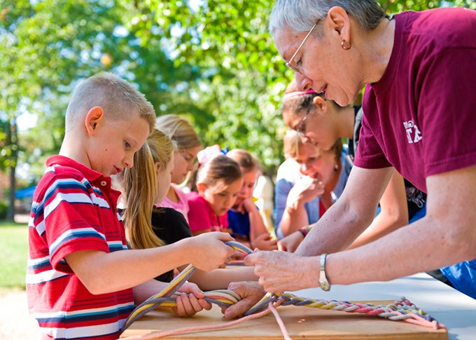 Students get firsthand experience with cultural arts such as finger weaving at the Cherokee Heritage Center during Indian Territory Days. - PROVIDED