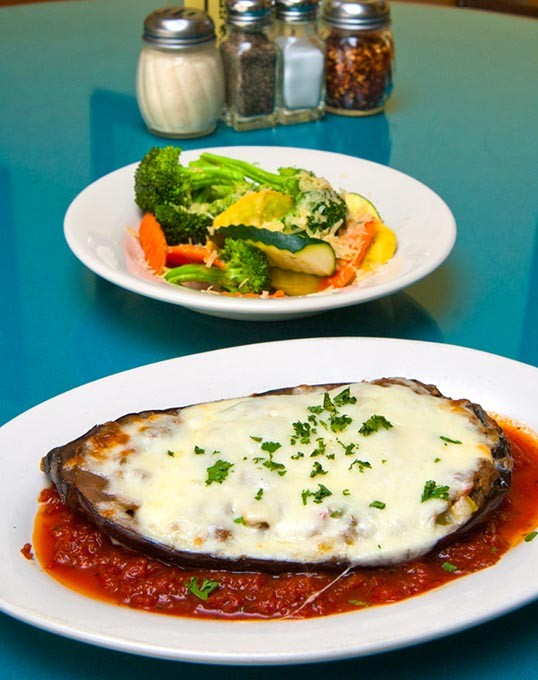 Baked Eggplant, this is the half dish, served with the generous veggie side dish, at Sergio's Italian Bistro in Norman.  mh