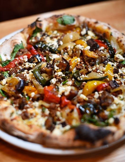 Lamb sausage pizza at Pizzeria Gusto, Tuesday, March 8, 2016. - GARETT FISBECK