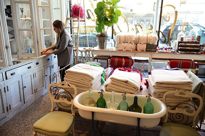 Sara Kate Huff, owner of Sara Kate Studios in Automobile Alley, works with her inventory at the new shop.  mh