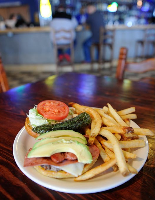 La Mexicana burger and fries at Medio Tiempo Sports Cantina and Grill in Oklahoma City, Friday, Feb. 6, 2015. - GARETT FISBECK
