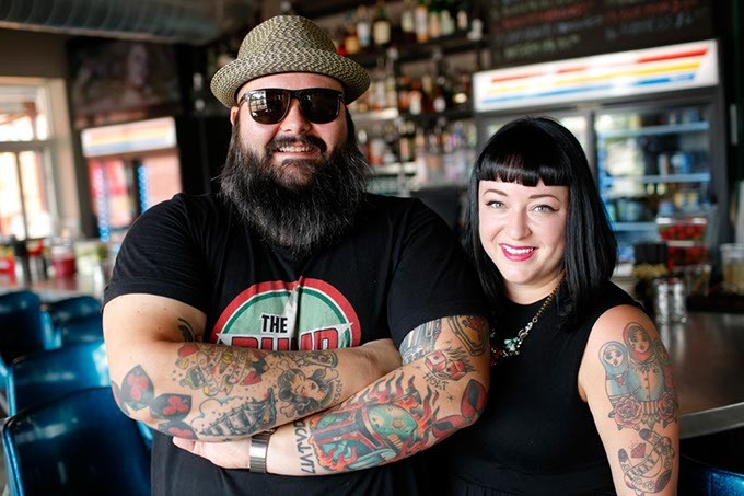 Ian and Hailey McDermid, owners, pose for a photo at the Pump Bar in Oklahoma City, Tuesday, Sept. 8, 2015. - GARETT FISBECK