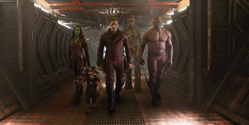 """Gamora (Zoe Saldana), left, Rocket Racoon (voiced by Bradley Cooper), Peter Quill/Star-Lord (Chris Pratt), Groot (voiced by Vin Diesel) and Drax the Destroyer (Dave Bautista) in a scene from the motion picture """"Guardians of the Galaxy."""" CREDIT: Marvel [Via MerlinFTP Drop] - NONE"""