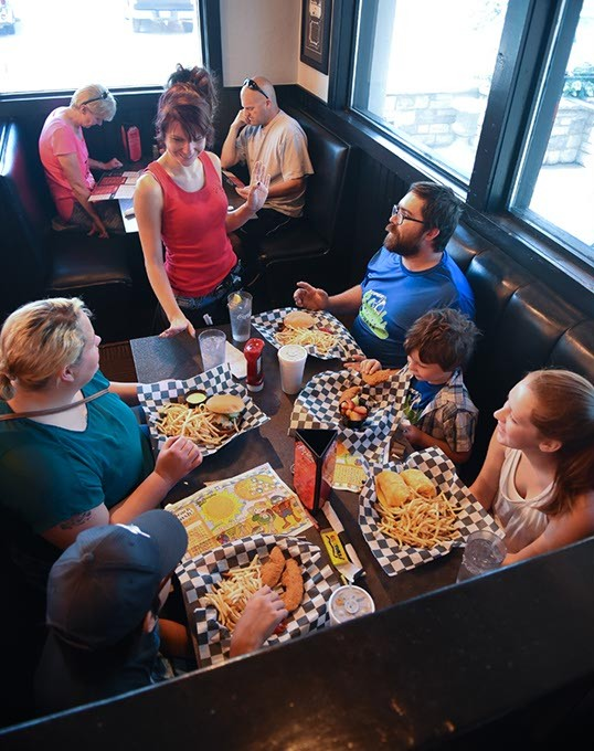 The Reid family group from Tulsa enjoys Louie's spacious accomodations, served by Kelly Menasco at the 412, S. Meridian Avenue location.  mh