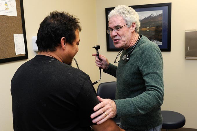 Dr. Fred Loper treats a patient at Good Shepherd in Oklahoma City, Wednesday, Dec. 2, 2015. - GARETT FISBECK