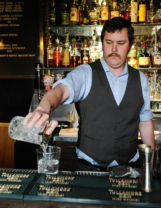 Bryan Moyer, general manager, pours a drink at R&J in Oklahoma City, Monday, Nov. 30, 2015. - GARETT FISBECK