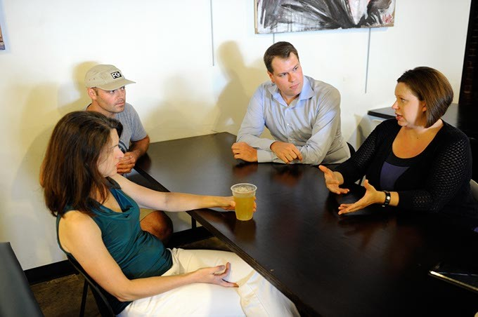 Julie Serven, Daniel McKinney, Matt Tilly and Jennifer Monies talk at District House in Oklahoma City, Tuesday, June 29, 2015. - GARETT FISBECK