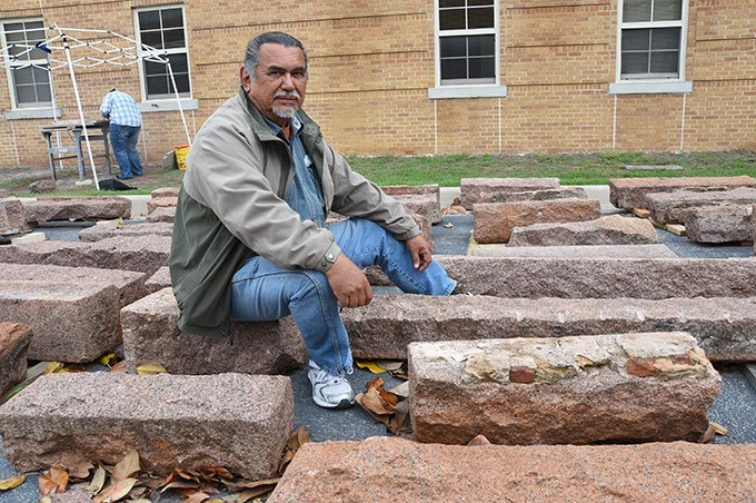 Artist-in-residence at USAO, Jesus Moroles, with granite blocks being used in the construction of Coming Together Park on the campus in Chickasha.  mh