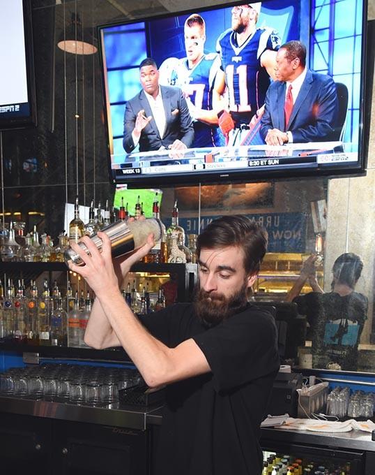 The bar tender ( I have his name) mixes a drink at Urban Jonnie Bar & Grill in Oklahoma City, 11-30-15. - MARK HANCOCK