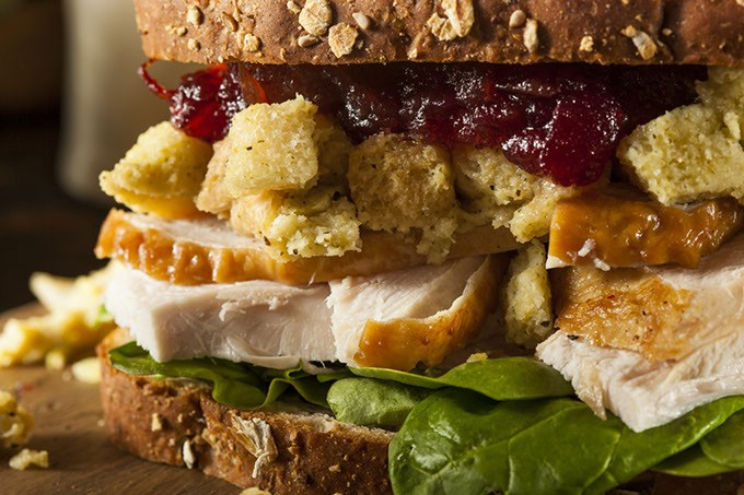 Homemade Leftover Thanksgiving Dinner Turkey Sandwich with Cranberries and Stuffing - BIGSTOCK