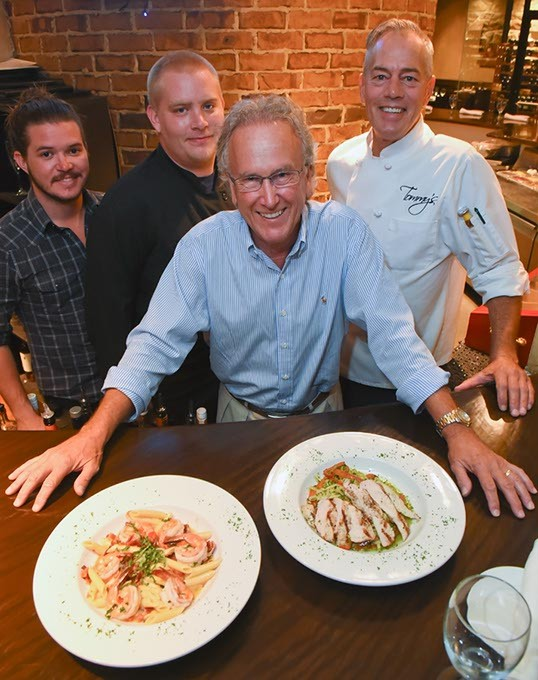 From left, Cody Stubblefield, Josh Tolle, Tommy Byrd (owner), and Tony Dorl, with Penne Arabiatta, left, and Cilantro Pesto Linguine, at Tommy's Italian-American Grill.