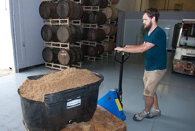 Anthem Brewing Company's brewer Will Perry moves used mash from the fermentation vessels. (Mark Hancock)