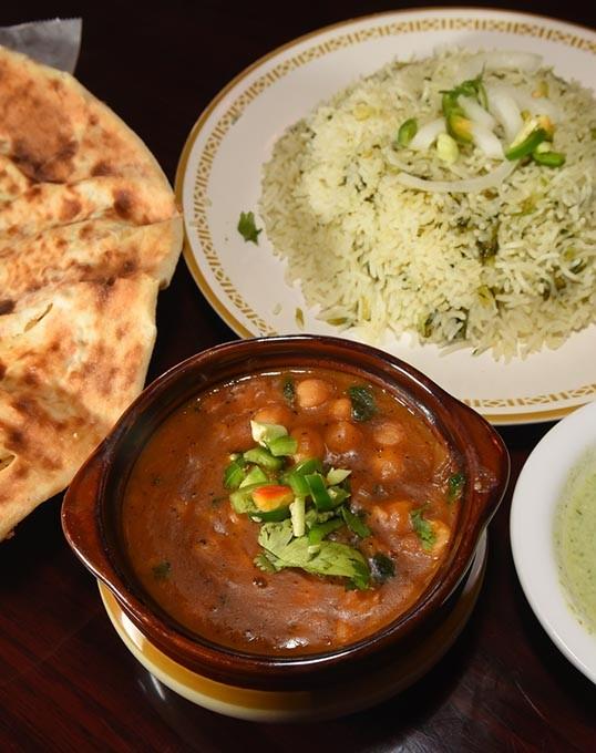 Chana Masala with green rice and hot green sauce and naan bread, at Sheesh Mahal.  mh