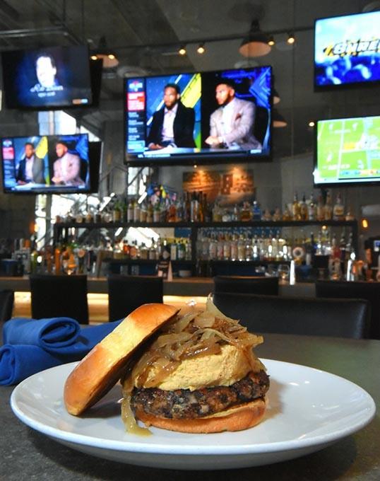 The Hummus A Tune burger, with TVs, at Urgan Johnnie in Deep Deuce, Oklahoma City, 2-11-16. - MARK HANCOCK