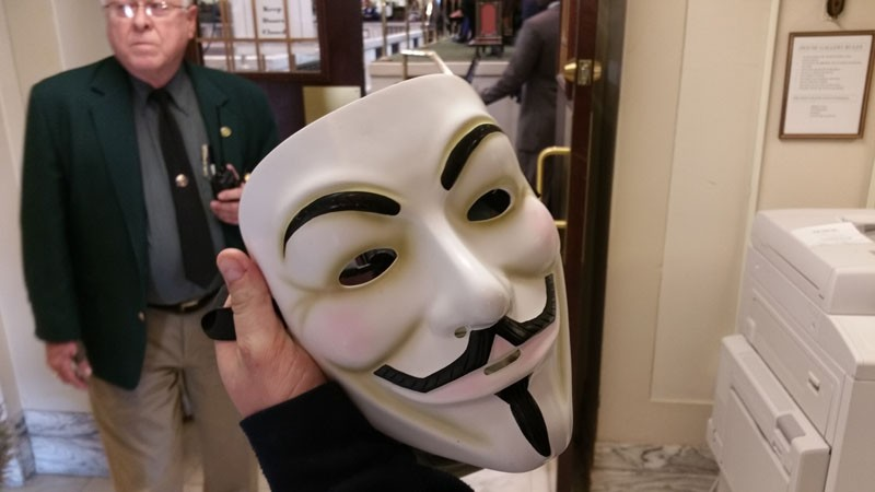 A visitor to the capitol shows his mask he wanted to wear inside the House gallery. - BEN FELDER