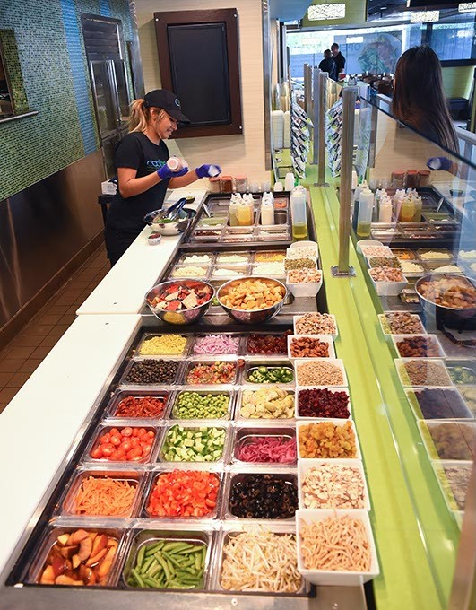 Priscila Solis prepares an order for a customer in the Downtown OKC Coolgreens, 9-11-15. - MARK HANCOCK