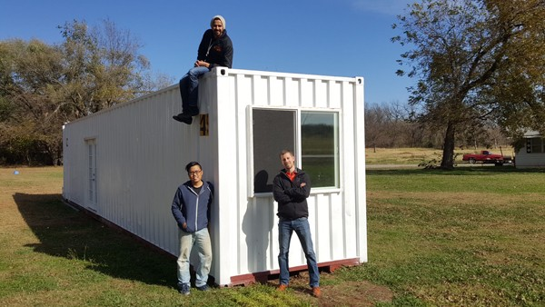 Clockwise from lower left, Ben Loh, Swapneel Deshpande, and Lee Easton, with the prototype ModernBlox container home in Stillwater. - PROVIDED
