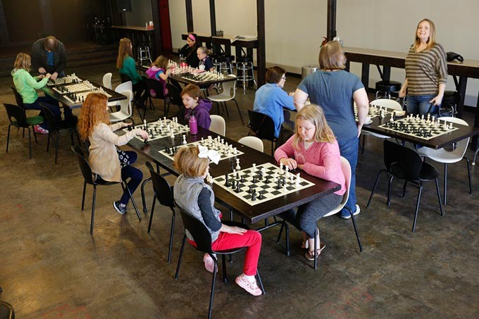 Girls' and Women's Chess Club meet the last Saturday of each month at District House, located in Plaza District. (Garett Fisbeck)