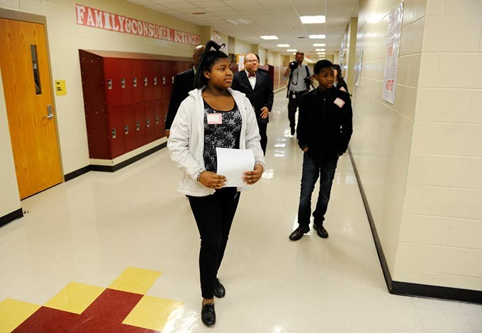 Breyell Thompson, left, and Jemi Thompson lead a tour at Centennial High School in Oklahoma City, Wednesday, Jan. 28, 2015. - GARETT FISBECK
