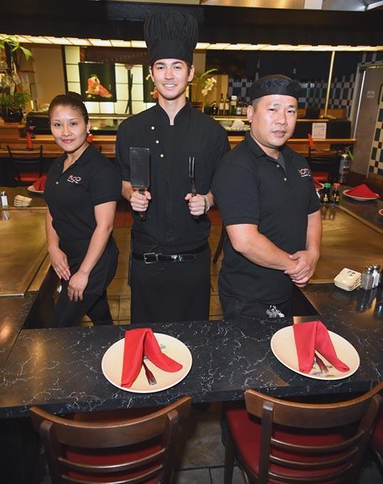 Koto Japanese Steakhouse, from left, Cecilia Haynes-waitress, Shingi Campbell-habachi chef, and Tri Vu-sushi chef.  mh