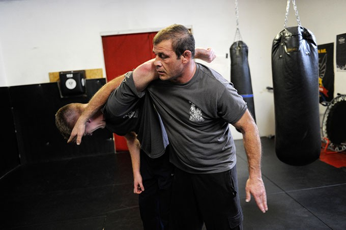 Travis Hoffman, right, trains with Blake LeBlanc, left, at Western Avenue Boxing in Oklahoma City, Dec. 3, 2014. - GARETT FISBECK