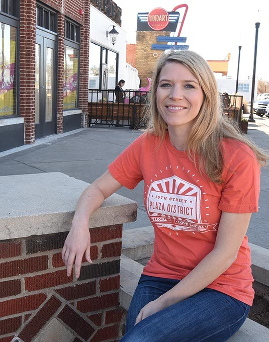 Kristin Vails has a new job, photographed in the Plaza District where she served as director.  mh