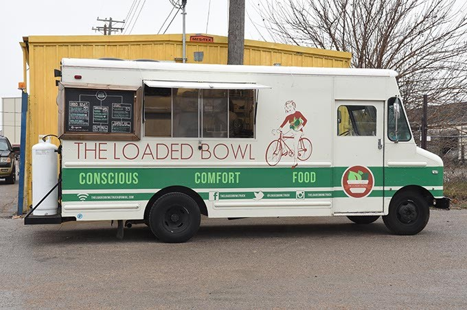 parked across from the Urban Agrarian on Sundays where customers who order prepared meals can pick them up.  mh