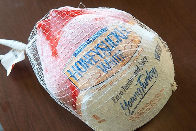A frozen turkey donated for this year's food basket distribution campaign, in the Jesus House warehouse recently.  mh
