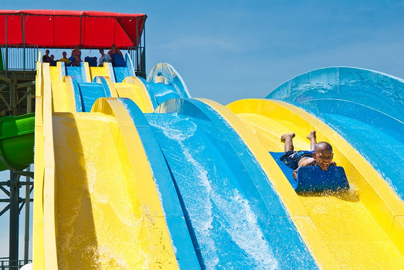 A boy races down the big slide at Andy Alligator's Water Park. - MARK HANCOCK