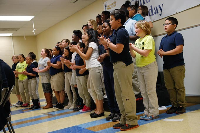 A youth choir performs during a ceremony at Bodine Elementary School in Oklahoma City, Monday, May 11, 2015. - GARETT FISBECK
