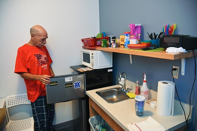Randy Brown seems to enjoy the amenities at his new home in the West Town Apartments, on the property of the WestTown Homeless Resource Campus in Oklahoma City, 9-21-15. - MARK HANCOCK