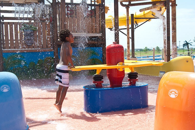 A boy gets down with the water toys at Andy Alligator's water park recently.