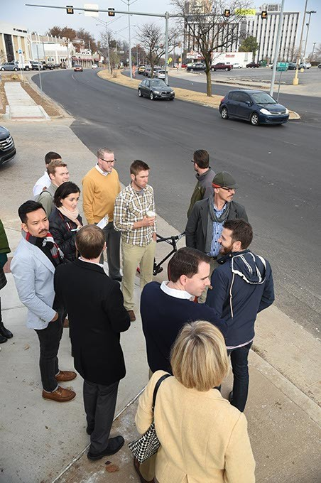 A group of urban plannerss, city officials and residents near the intersection of N.W.17th and Classen Blvd., discusses ongoing improvements, 12-11-14.  mh